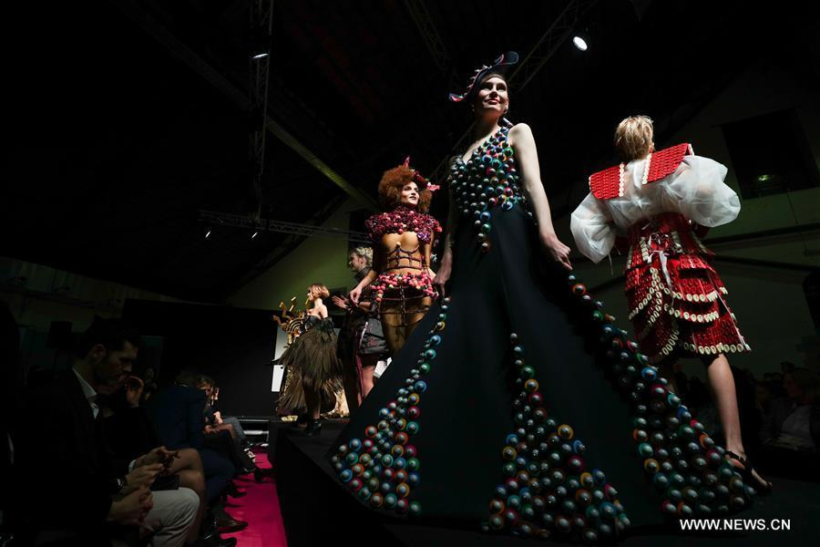 Models display chocolate dresses during the opening show of the 6th Brussels Chocolate Salon in Brussels, Belgium, Feb. 21, 2019. The 6th Brussels Chocolate Salon (Salon du Chocolat Brussels) kicked off here on Thursday. In the following three days, 130 chocolatiers, pastry chefs, confectioners, designers and cocoa experts of international reputation in attendance will share and exhibit chocolate in all its delectable forms. (Xinhua/Zheng Huansong)