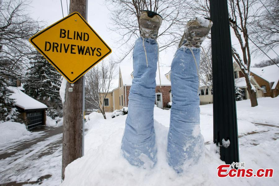 An upside-down pair of pants is seen atop a mound of snow, Feb. 20, 2019, the result of yet another snow storm to hit Omaha, Nebraska. The latest winter storm dumped more snow on top of the existing snow, creating a problem of what to do with all the cleared snow. (Photo/Agencies)