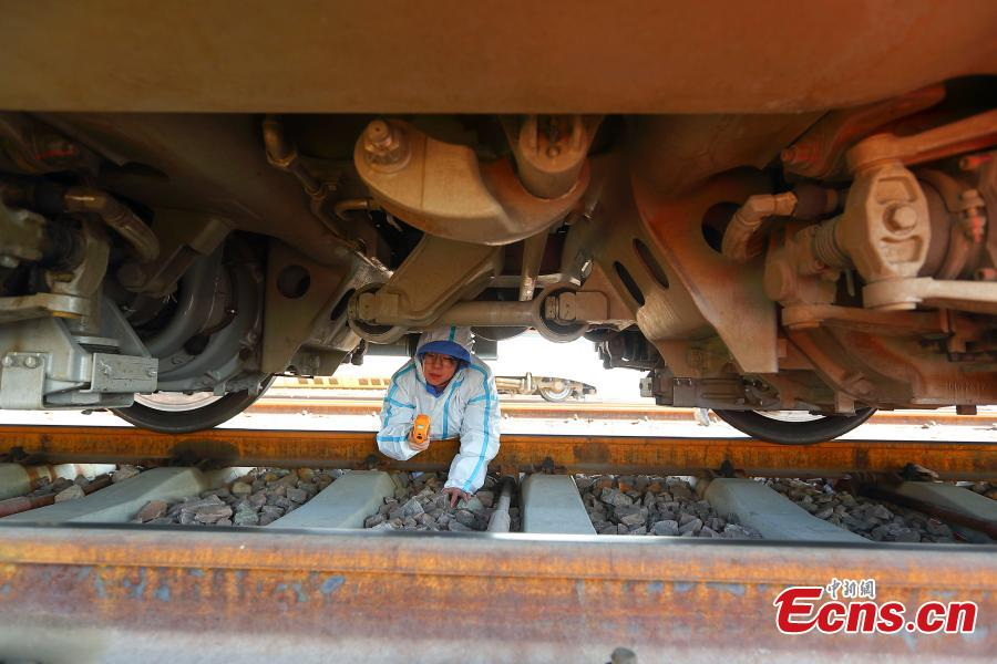 A technician participates in a drill simulating a mechanical failure on a high-speed train in Taiyuan, North China's Shanxi Province, Feb. 21, 2019. The team at the high-speed train service station in Taiyuan, established on March 8, 2018, is comprised of 19 female technicians with an average age of 23 years, the first its kind in China. They are responsible for emergency responses related to high-speed trains heading to Beijing. (Photo: China News Service/Zhang Yun)
