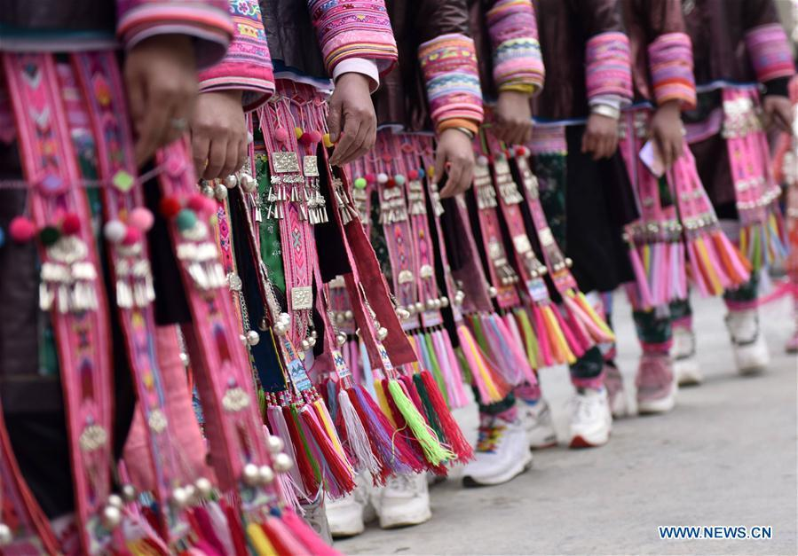 People of the Miao ethnic group dance to the Lusheng, a reed-pipe wind instrument, to celebrate their new life at the relocated Fengle community in Rongjiang County, southwest China\'s Guizhou Province, Feb. 21, 2019. The relocated ethnic Miao people from remote areas to the community held a gathering Thursday by inviting neighboring Miao villages\' Lusheng teams to celebrate their new life. (Xinhua/Jiang Zuoxian)