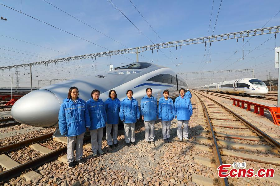 Technicians pose after a drill simulating a mechanical failure on a high-speed train in Taiyuan, North China's Shanxi Province, Feb. 21, 2019. The team at the high-speed train service station in Taiyuan, established on March 8, 2018, is comprised of 19 female technicians with an average age of 23 years, the first its kind in China. They are responsible for emergency responses related to high-speed trains heading to Beijing. (Photo: China News Service/Zhang Yun)
