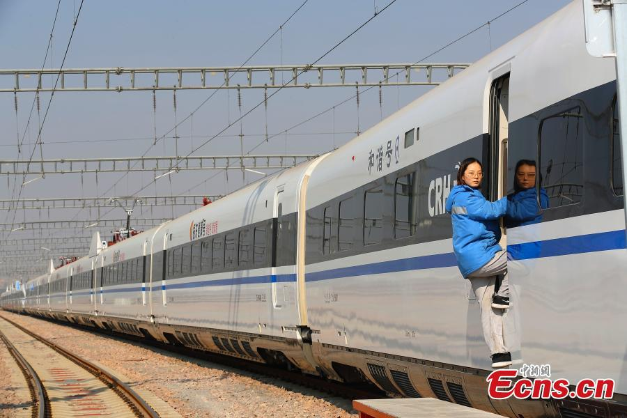Pang Yidan participates in a drill simulating a mechanical failure on a high-speed train in Taiyuan, North China's Shanxi Province, Feb. 21, 2019. The team at the high-speed train service station in Taiyuan, established on March 8, 2018, is comprised of 19 female technicians with an average age of 23 years, the first its kind in China. They are responsible for emergency responses related to high-speed trains heading to Beijing. (Photo: China News Service/Zhang Yun)