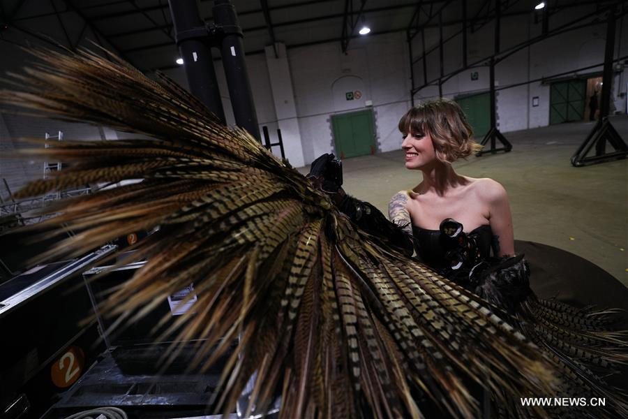 A model makes a video phone call backstage during the opening show of the 6th Brussels Chocolate Salon in Brussels, Belgium, Feb. 21, 2019. The 6th Brussels Chocolate Salon (Salon du Chocolat Brussels) kicked off here on Thursday. In the following three days, 130 chocolatiers, pastry chefs, confectioners, designers and cocoa experts of international reputation in attendance will share and exhibit chocolate in all its delectable forms. (Xinhua/Zheng Huansong)
