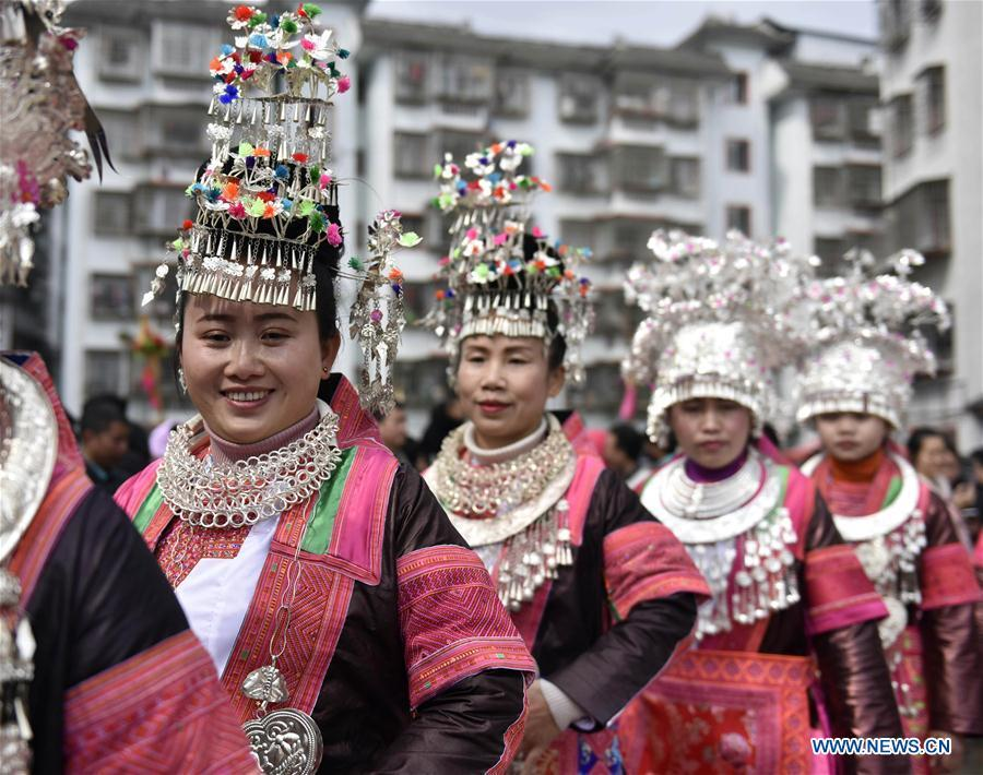 People of the Miao ethnic group dance to the Lusheng, a reed-pipe wind instrument, to celebrate their new life at the relocated Fengle community in Rongjiang County, southwest China\'s Guizhou Province, Feb. 21, 2019. The relocated ethnic Miao people from remote areas to the community held a gathering Thursday by inviting neighboring Miao villages\' Lusheng teams to celebrate their new life.(Xinhua/Jiang Zuoxian)