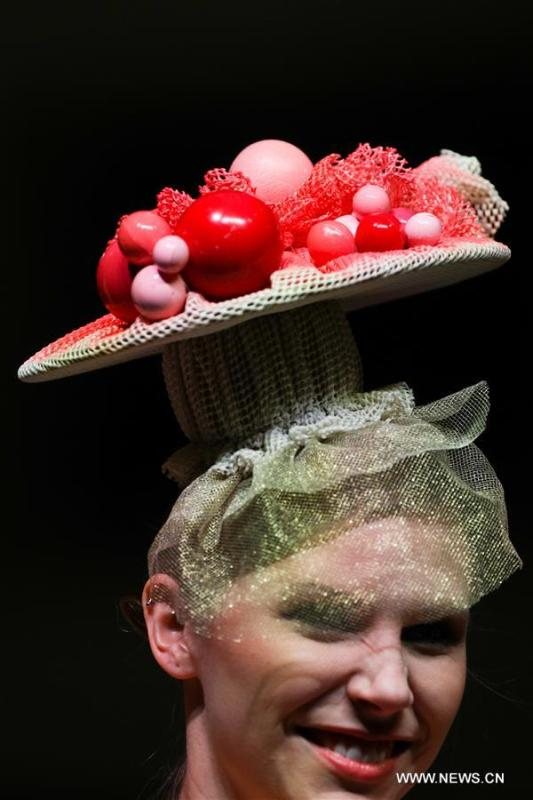 A model wears a chocolate headdress during the opening show of the 6th Brussels Chocolate Salon in Brussels, Belgium, Feb. 21, 2019. The 6th Brussels Chocolate Salon (Salon du Chocolat Brussels) kicked off here on Thursday. In the following three days, 130 chocolatiers, pastry chefs, confectioners, designers and cocoa experts of international reputation in attendance will share and exhibit chocolate in all its delectable forms. (Xinhua/Zheng Huansong)