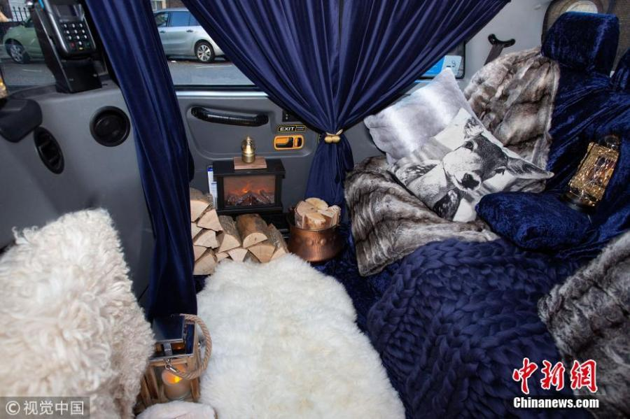 The world's cosiest taxi has been unveiled in London featuring velvet seats, sheepskin rugs -- and a roaring fireplace. The one-of-a kind taxi has been decked out to resemble a country log cabin. Passengers in the cab will even be given a pair of sheepskin slippers. The mobile log cabin is currently being trialed and will be picking up commuters from all across the city for free. (Photo/VCG)