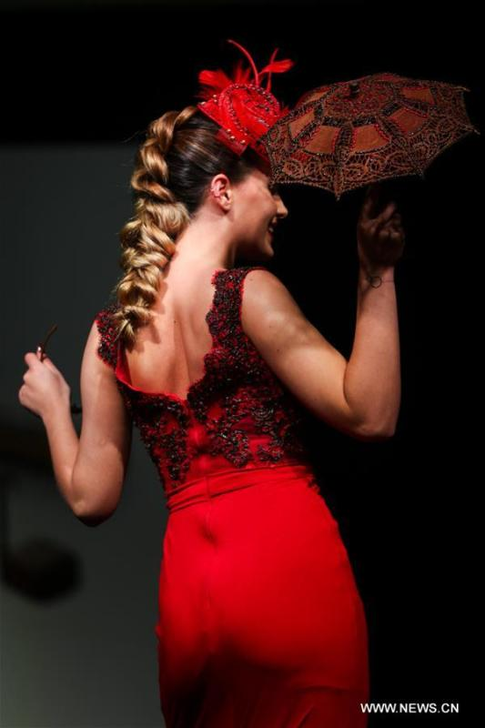 A model attends the opening show of the 6th Brussels Chocolate Salon in Brussels, Belgium, Feb. 21, 2019. The 6th Brussels Chocolate Salon (Salon du Chocolat Brussels) kicked off here on Thursday. In the following three days, 130 chocolatiers, pastry chefs, confectioners, designers and cocoa experts of international reputation in attendance will share and exhibit chocolate in all its delectable forms. (Xinhua/Zheng Huansong)