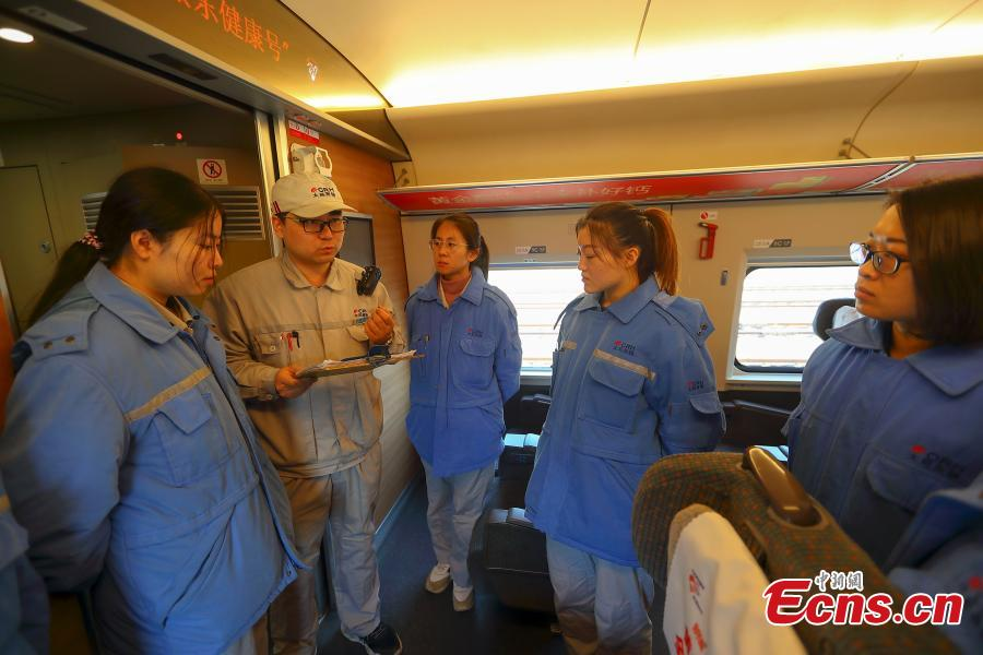 Instructor Yang Shen talks to technicians during a drill simulating a mechanical failure on a high-speed train in Taiyuan, North China's Shanxi Province, Feb. 21, 2019. The team at the high-speed train service station in Taiyuan, established on March 8, 2018, is comprised of 19 female technicians with an average age of 23 years, the first its kind in China. They are responsible for emergency responses related to high-speed trains heading to Beijing. (Photo: China News Service/Zhang Yun)