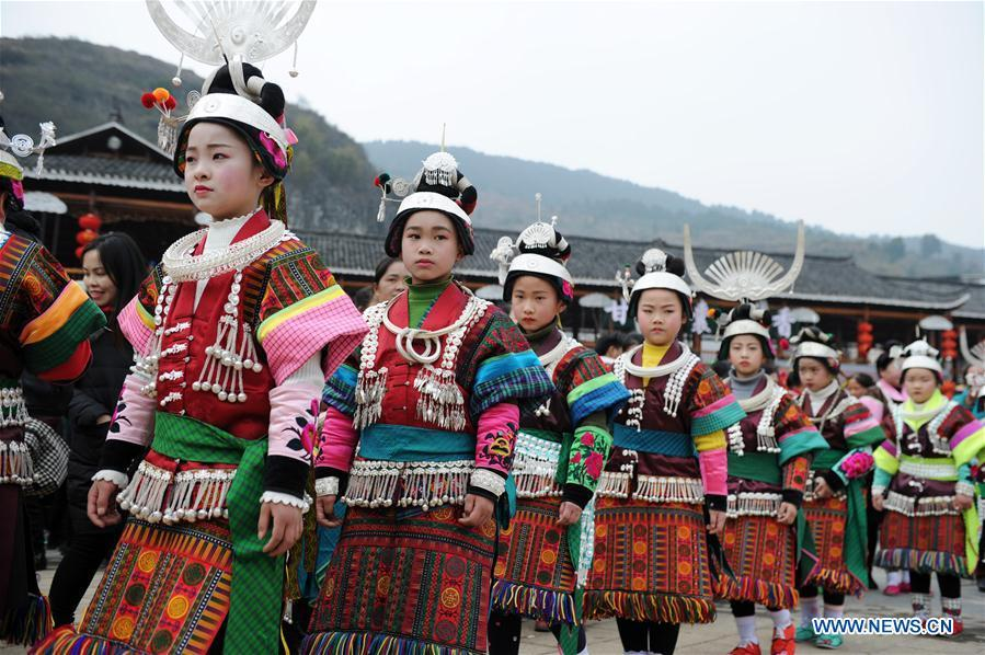 Villagers in traditional costumes perform the lusheng dance in Zhouxi Town, Kaili City of southwest China\'s Guizhou Province, Feb. 24, 2019. The ethnic Miao girls donning traditional embroidered attire and silver ornaments sing and dance to the sound of the lusheng, a reed-pipe wind instrument, to pray for a good harvest. Ethnic Miao people get together at Gannangxiang to rejoice in the annual Gannangxiang celebration, one of the largest-scale and most primitive Miao lusheng celebrations in Guizhou Province. (Xinhua/Yang Wenbin)
