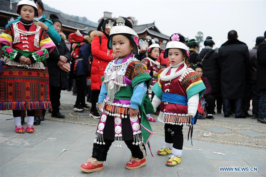 Kids in traditional costumes perform the lusheng dance in Zhouxi Town, Kaili City of southwest China\'s Guizhou Province, Feb. 24, 2019. The ethnic Miao girls donning traditional embroidered attire and silver ornaments sing and dance to the sound of the lusheng, a reed-pipe wind instrument, to pray for a good harvest. Ethnic Miao people get together at Gannangxiang to rejoice in the annual Gannangxiang celebration, one of the largest-scale and most primitive Miao lusheng celebrations in Guizhou Province. (Xinhua/Yang Wenbin)
