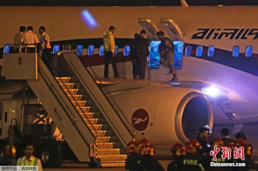 Security personnel check the hijacked aircraft of the Biman Bangladesh Airlines in the Shah Amanat International Airport in Chattogram, Bangladesh, Feb. 24, 2019. (Photo/Agencies)