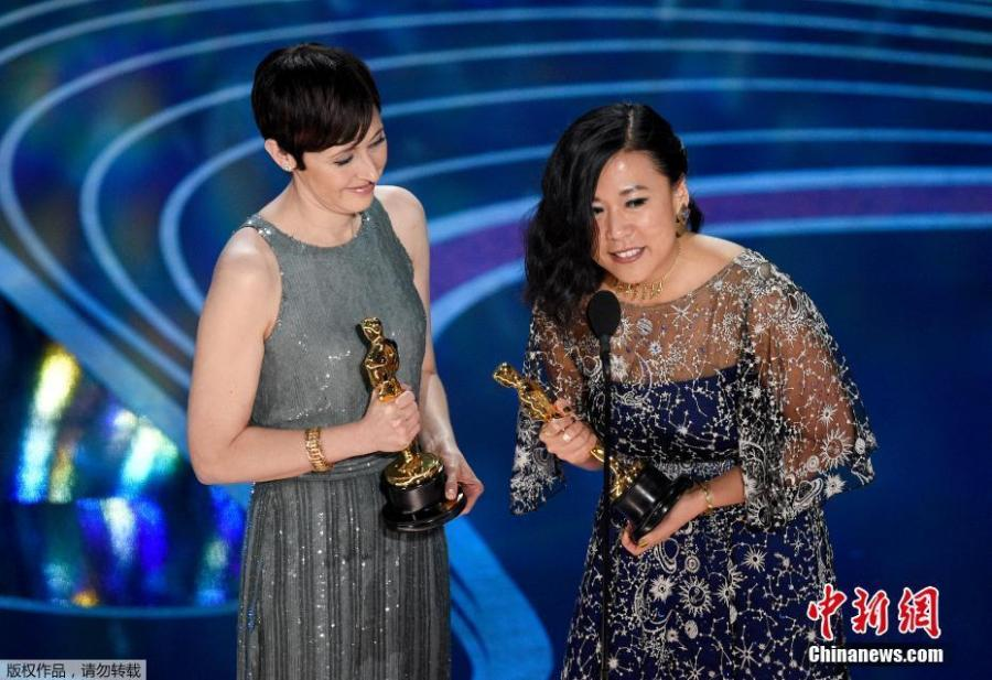 Becky Neiman-Cobb and Domee Shi (right) accept the Short Film (Animated) award for Bao onstage during the 91st Annual Academy Awards at Dolby Theatre on Feb. 24, 2019 in Hollywood, California.  (Photo/Agencies)