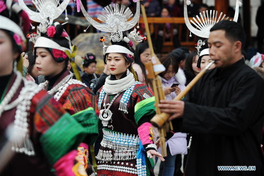 People in traditional costumes perform the lusheng dance in Zhouxi Town, Kaili City of southwest China\'s Guizhou Province, Feb. 24, 2019. The ethnic Miao girls donning traditional embroidered attire and silver ornaments sing and dance to the sound of the lusheng, a reed-pipe wind instrument, to pray for a good harvest. Ethnic Miao people get together at Gannangxiang to rejoice in the annual Gannangxiang celebration, one of the largest-scale and most primitive Miao lusheng celebrations in Guizhou Province. (Xinhua/Yang Wenbin)