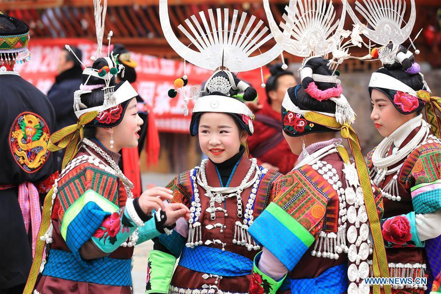 Villagers in traditional costumes are seen during the Gannangxiang celebration in Zhouxi Town, Kaili City of southwest China\'s Guizhou Province, Feb. 24, 2019. The ethnic Miao girls donning traditional embroidered attire and silver ornaments sing and dance to the sound of the lusheng, a reed-pipe wind instrument, to pray for a good harvest. Ethnic Miao people get together at Gannangxiang to rejoice in the annual Gannangxiang celebration, one of the largest-scale and most primitive Miao lusheng celebrations in Guizhou Province. (Xinhua/Wu Jibin)