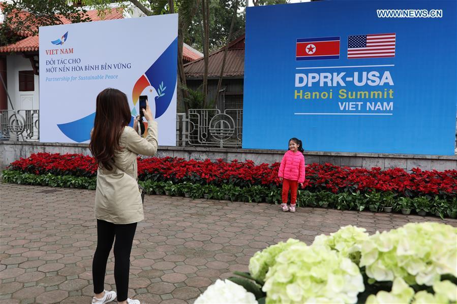 A child poses for photos outside the International Media Center for the second summit between the Democratic People\'s Republic of Korea (DPRK) and the United States in Hanoi, Vietnam, on Feb. 24, 2019. The second DPRK-U.S. summit is scheduled to be held in Hanoi on Feb. 27-28. (Xinhua/Wang Di)