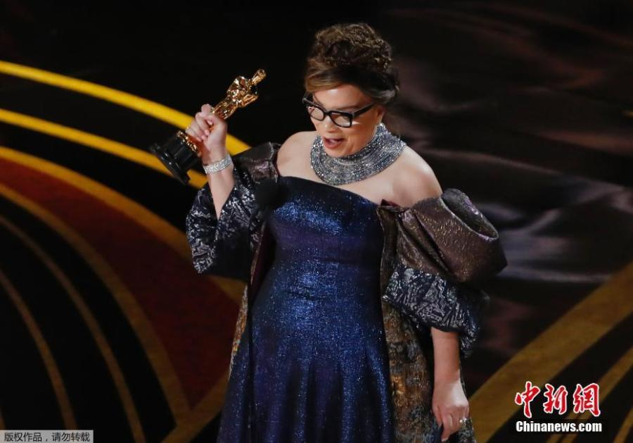 Ruth Carter accepts Costume Design award for \