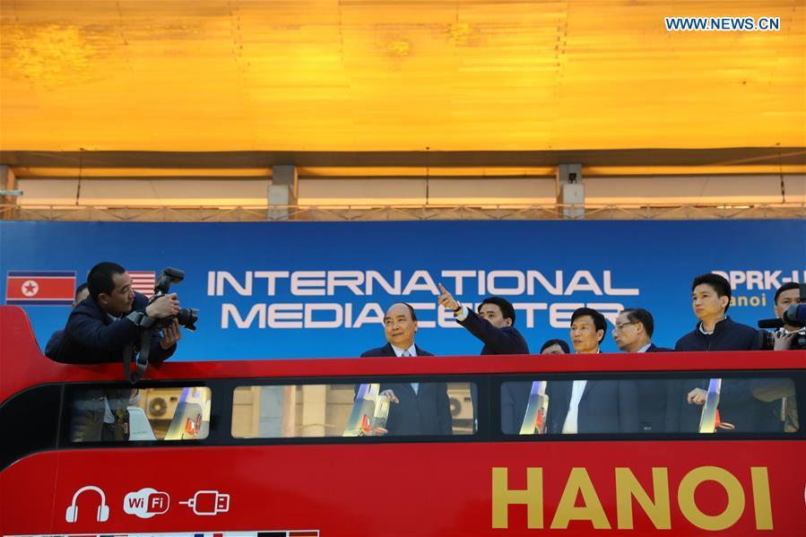 Vietnamese Prime Minister Nguyen Xuan Phuc (2nd L) visits the International Media Center for the second summit between the Democratic People\'s Republic of Korea (DPRK) and the United States in Hanoi, Vietnam, on Feb. 24, 2019. The second DPRK-U.S. summit is scheduled to be held in Hanoi on Feb. 27-28. (Xinhua/Wang Di)