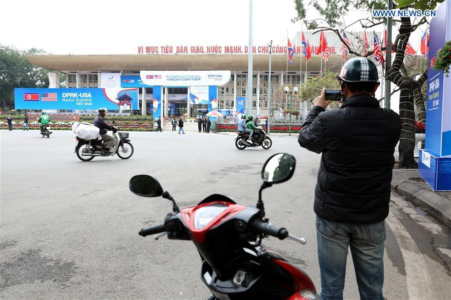 A man takes photos of the International Media Center for the second summit between the Democratic People\'s Republic of Korea (DPRK) and the United States in Hanoi, Vietnam, on Feb. 24, 2019. The second DPRK-U.S. summit is scheduled to be held in Hanoi on Feb. 27-28. (Xinhua/Wang Di)