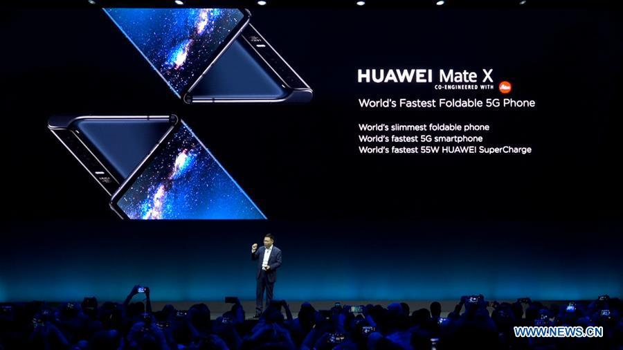 Richard Yu, CEO of Consumer Business Group of Chinese tech company Huawei, presents the new Mate X, a foldable 5G ready smartphone, ahead of the Mobile World Congress in Barcelona, Spain, Feb. 24, 2019. (Xinhua)
