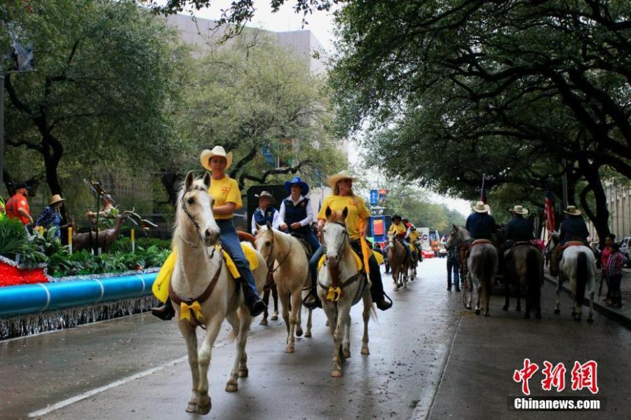 The Downtown Rodeo Parade in Houston, U.S., Feb. 23, 2019. The annual event celebrates Western heritage and marks the beginning of the Houston Livestock Show and Rodeo season, a tradition since 1938. (Photo: China News Service/Li Ang)
