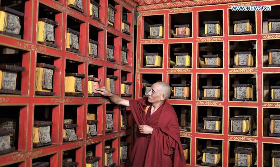 A monk of the Potala Palace arranges documents in Lhasa, capital of southwest China\'s Tibet Autonomous Region, Nov. 15, 2018. The Chinese government will invest 300 million yuan (44.9 million U.S. dollars) in the next 10 years in its greatest efforts of protection and utilization of ancient documents in the Potala Palace, a World Heritage site in Lhasa, southwest China\'s Tibet Autonomous Region, according to the management office of the Potala Palace. (Xinhua/Purbu Zhaxi)