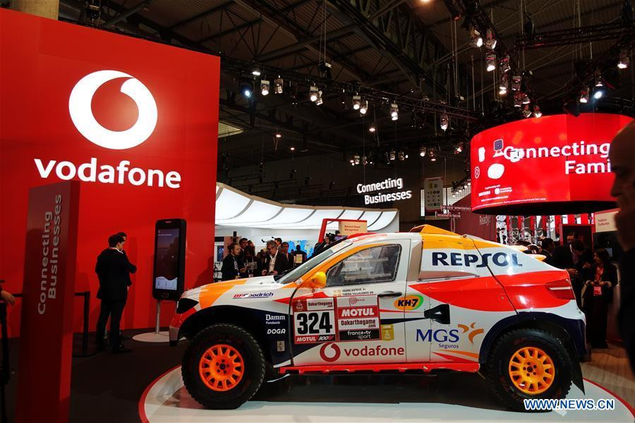 People are seen at the booth of mobile company Vodafone at the 2019 Mobile World Congress (MWC) in Barcelona, Spain, Feb. 25, 2019. The four-day 2019 MWC opened on Monday in Barcelona. (Xinhua/Guo Qiuda)