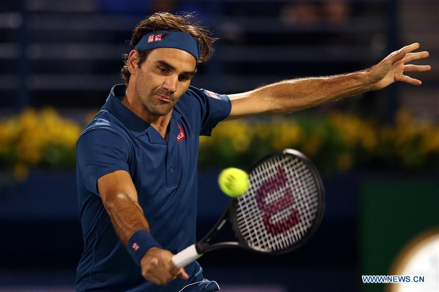 Roger Federer of Switzerland hits a return during the singles first round match between Roger Federer of Switzerland and Philipp Kohlschreiber of Germany at the ATP Dubai Duty Free Tennis Championships 2019 in Dubai, the United Arab Emirates, Feb. 25, 2019. Roger Federer won 2-1. (Xinhua/Mahmoud Khaled)