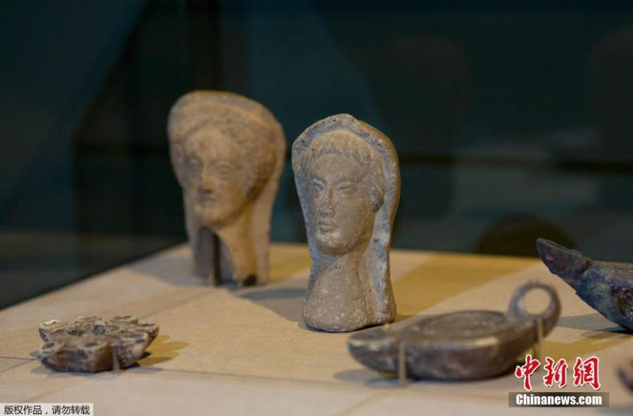 Anthropomorphic heads rescued from the ashes of last year\'s fire that swept through the National Museum are displayed at the Bank of Brazil Cultural Center in Rio de Janeiro on Feb 25, 2019. The exhibit is titled \