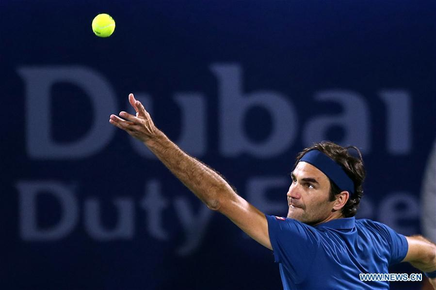 Roger Federer of Switzerland serves during the singles first round match between Roger Federer of Switzerland and Philipp Kohlschreiber of Germany at the ATP Dubai Duty Free Tennis Championships 2019 in Dubai, the United Arab Emirates, Feb. 25, 2019. Roger Federer won 2-1. (Xinhua/Mahmoud Khaled)