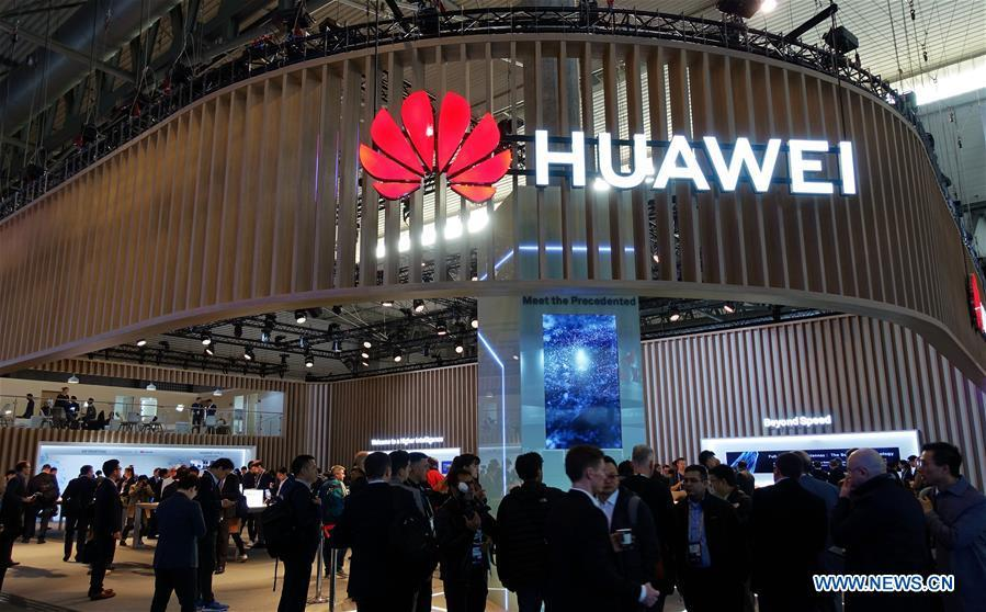 People are seen at the booth of Chinese tech company Huawei at the 2019 Mobile World Congress (MWC) in Barcelona, Spain, Feb. 25, 2019. The four-day 2019 MWC opened on Monday in Barcelona. (Xinhua/Guo Qiuda)
