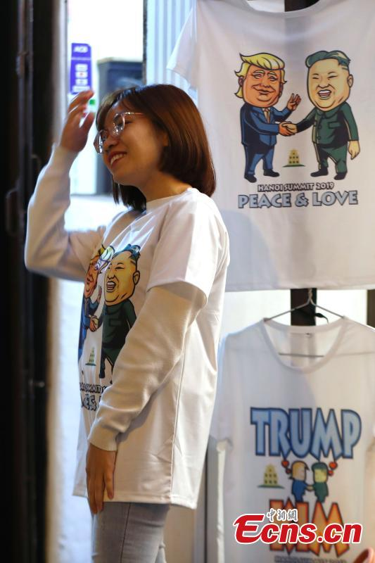 T-shirts emblazoned with depictions of Kim Jong Un, the leader of the Democratic People\'s Republic of Korea, and U.S. President Donald Trump are on display ahead of a summit in Hanoi, Vietnam Feb. 25, 2019. (Photo: China News Service/Fu Tian)