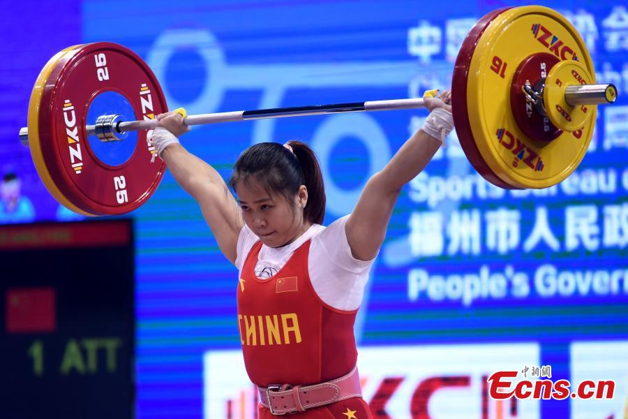 Deng Wei competes during the women\'s weightlifting 64kg event at 2019 IWF World Cup & Qualification Event For 2020 Tokyo Olympic Games in Fuzhou, southeast China\'s Fujian Province, Feb. 25, 2019. (Photo: China News Service/Zhang Bin)