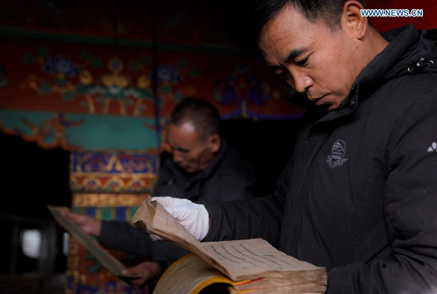 Staff members of the Potala Palace work on registration of ancient documents in Lhasa, capital of southwest China\'s Tibet Autonomous Region, Nov. 16, 2018. The Chinese government will invest 300 million yuan (44.9 million U.S. dollars) in the next 10 years in its greatest efforts of protection and utilization of ancient documents in the Potala Palace, a World Heritage site in Lhasa, southwest China\'s Tibet Autonomous Region, according to the management office of the Potala Palace. (Xinhua/Purbu Zhaxi)
