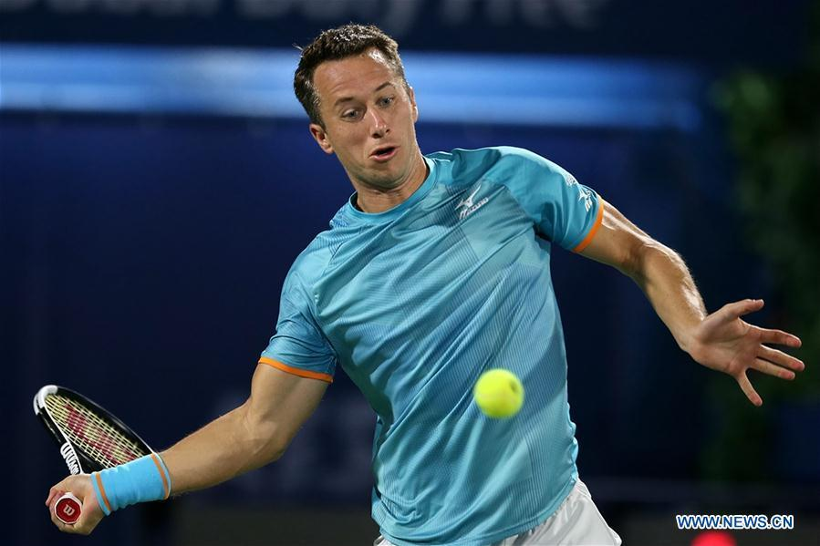 Philipp Kohlschreiber of Germany hits a return during the singles first round match between Roger Federer of Switzerland and Philipp Kohlschreiber of Germany at the ATP Dubai Duty Free Tennis Championships 2019 in Dubai, the United Arab Emirates, Feb. 25, 2019. Roger Federer won 2-1. (Xinhua/Mahmoud Khaled)