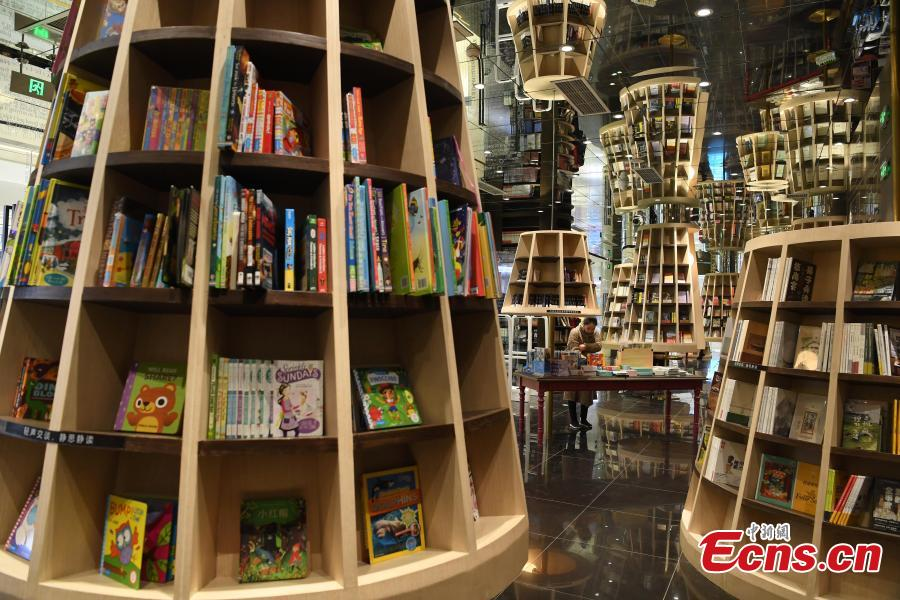 A view of the bookshelves at a bookstore in Chongqing southwestern China, Feb. 25, 2019.   The newly opened bookstore in Chongqing southwestern China has attracted over 200,000 visitors since it opened on Jan. 25.  The store quickly gained attention for its mind-boggling interior design.  (Photo/China News Service)