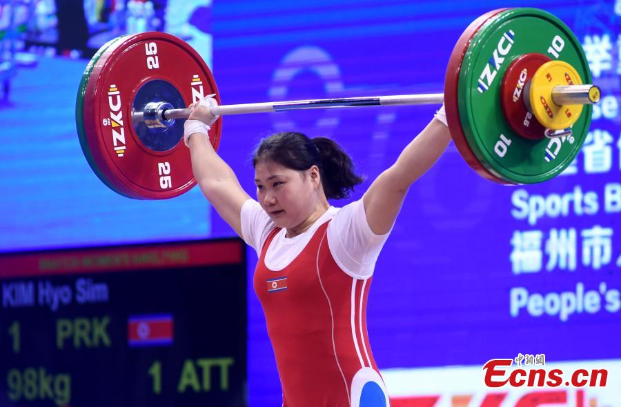 Kim Hyo Sim of the Democratic People\'s Republic of Korea (DPRK) competes during the women\'s weightlifting 64kg event at 2019 IWF World Cup & Qualification Event For 2020 Tokyo Olympic Games in Fuzhou, southeast China\'s Fujian Province, Feb. 25, 2019. (Photo: China News Service/Zhang Bin)