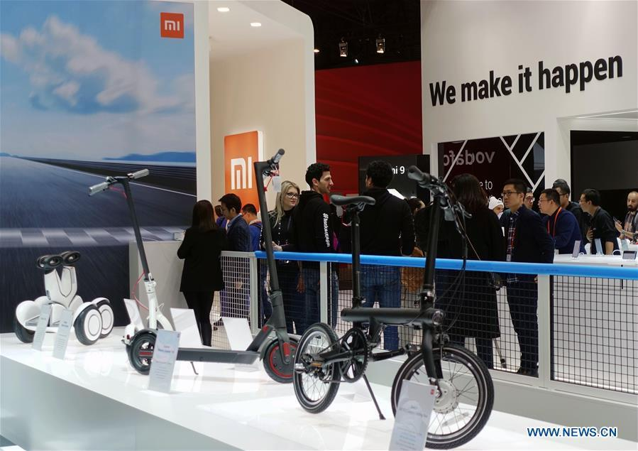 People are seen at the booth of Chinese tech company Xiaomi at the 2019 Mobile World Congress (MWC) in Barcelona, Spain, Feb. 25, 2019. The four-day 2019 MWC opened on Monday in Barcelona. (Xinhua/Guo Qiuda)