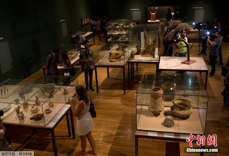 Journalists see archeological pieces rescued from the ashes of last year\'s fire that swept through the National Museum in Brazil, Feb. 25, 2019. The exhibit is titled \