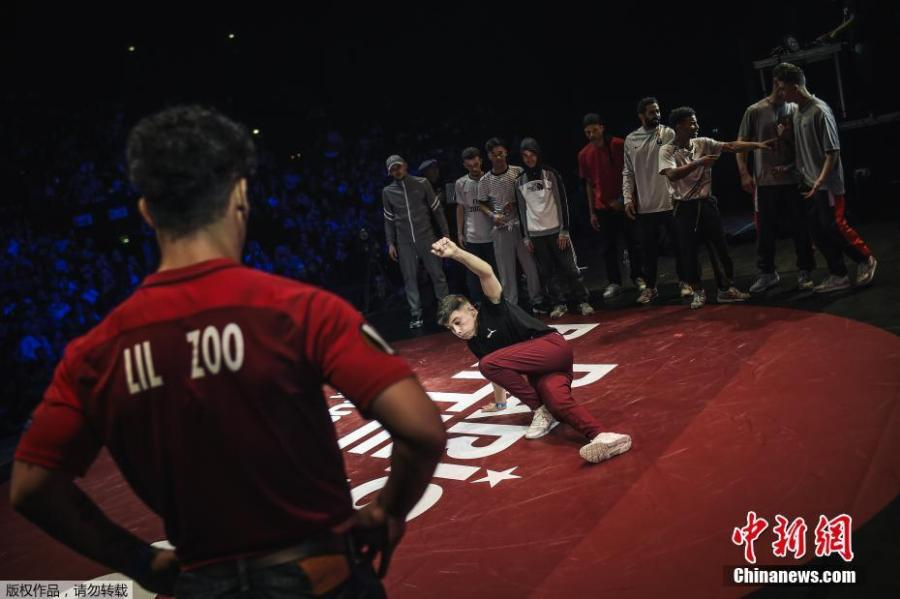 Dancers execute backflips and freezes, gyros and headspins with gravity-defying agility in front of an adoring audience at Battle Pro in Paris, France, Feb. 23, 2019. Organizers of Paris 2024 have proposed that breakdancing should be included as a new sport in the Olympic program. (Photo/Agencies)