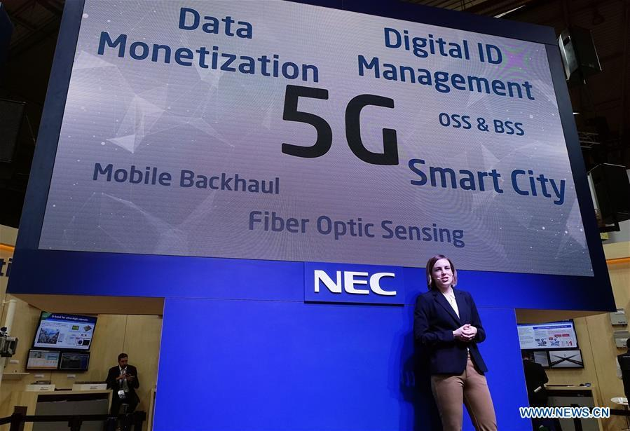 Japan\'s NEC holds a presentation about its 5G projects at Mobile World Congress (MWC 2019) in Barcelona, Spain, Feb. 26, 2019. The four-day MWC 2019 opened its door on Monday, which presents the newest 5G products of the high-tech giants from all around the world. (Xinhua/Guo Qiuda)
