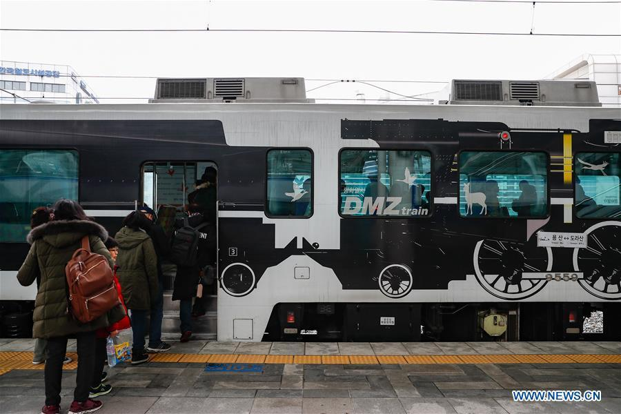 Passengers board a DMZ train at Seoul Railway Station in Seoul, South Korea, Feb. 20, 2019. Created in 1953 when the three-year Korean War ended with armistice, the Demilitarized Zone (DMZ) has long been a symbol of both confrontation and peace as tensions or rapprochement across the inter-Korean border can be felt firsthand in the 250-km-long strip of no-man\'s land. The DMZ Train departed Seoul Station for Dorasan Station, the northernmost station of the ROK just about 50 km north of Seoul and only 700 meters south of the southern boundary of the 4-km-wide DMZ. (Xinhua/Wang Jingqiang)