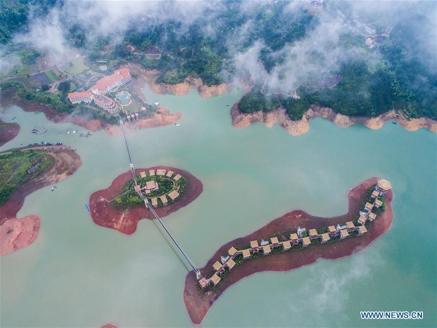 Aerial photo taken on May 31, 2018 shows Yunhe lake tourist resort in Yunhe County, Lishui City, east China\'s Zhejiang Province. China Development Bank (CDB), the world\'s largest development finance institution, has extended trillions of yuan of loans to support the development of the Yangtze River Economic Belt. As of December 2018, outstanding loans to 11 provincial-level regions along the belt amounted to 3.85 trillion yuan (about 575 billion U.S. dollars), according to the CDB. New yuan loans to these regions reached 304.5 billion yuan last year, accounting for 48 percent of the bank\'s total new yuan loans. The funds mainly went to major projects in the fields of ecological protection and restoration, infrastructure connectivity, and industrial transformation and upgrading. The CDB will continue to support ecological protection and green development of the Yangtze River in 2019, said CDB Chairman Zhao Huan. China issued a development plan for the Yangtze River Economic Belt in September 2016 and a guideline for green development of the belt in 2017. The Yangtze River Economic Belt consists of nine provinces and two municipalities that cover roughly one-fifth of China\'s land. It has a population of 600 million and generates more than 40 percent of the country\'s GDP. (Xinhua/Xu Yu)