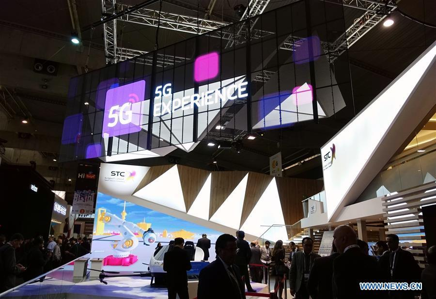 Saudi Telecom Company presents its booth with 5G mark at Mobile World Congress (MWC 2019) in Barcelona, Spain, Feb. 26, 2019. The four-day MWC 2019 opened its door on Monday, which presents the newest 5G products of the high-tech giants from all around the world. (Xinhua/Guo Qiuda)