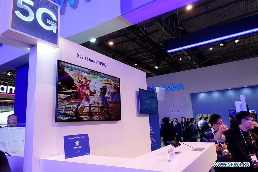 Chinese company OPPO presents its live 5G real-time multiplayer cloud gaming at Mobile World Congress (MWC 2019) in Barcelona, Spain, Feb. 25, 2019. The four-day MWC 2019 opened its door on Monday, which presents the newest 5G products of the high-tech giants from all around the world. (Xinhua/Guo Qiuda)