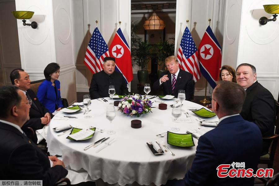 U.S. President Donald Trump and DPRK top leader Kim Jong-un sit down for a dinner during the second U.S.-DPRK summit at the Metropole Hotel in Hanoi, Vietnam February 27, 2019. Also pictured at right are U.S. Secretary of State Mike Pompeo and Acting White House Chief of Staff Mick Mulvaney. (Photo/Agencies)