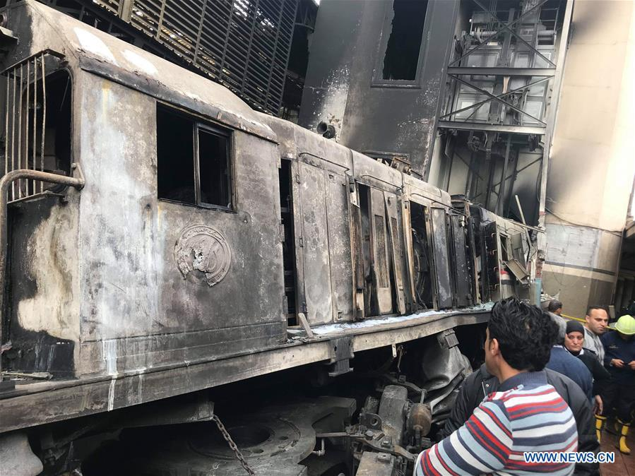 Photo taken on Feb. 27, 2019 shows a fire site at a train station in Cairo, Egypt. At least 25 people were killed and more than 40 others wounded when a fire erupted inside the main train station in the city center of Egypt\'s capital Cairo on Wednesday, state-run Nile TV reported. (Xinhua/Ahmed Gomaa)