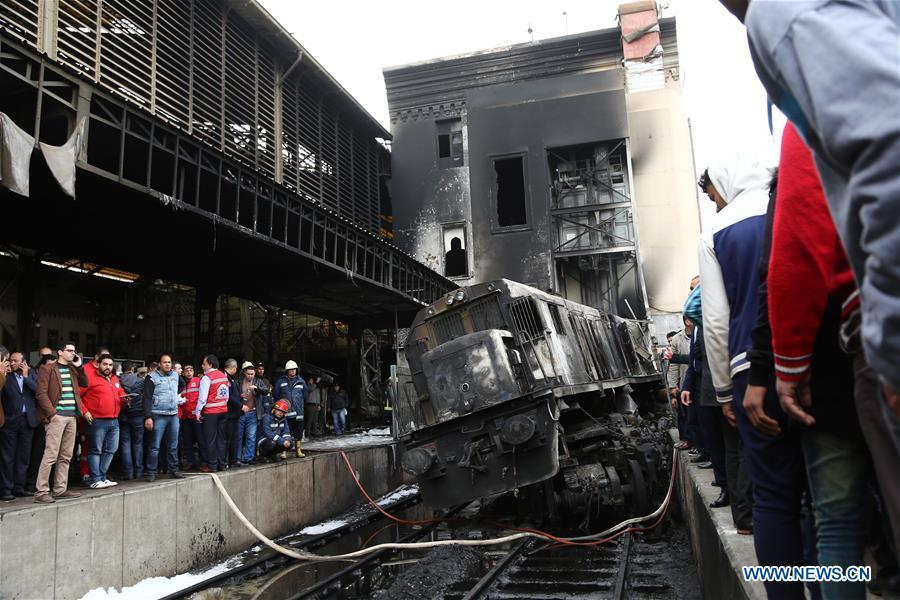 Photo taken on Feb. 27, 2019 shows the charred train at the train station after a fire in Cairo, Egypt. At least 25 people were killed and more than 40 others wounded when a fire erupted inside the main train station in the city center of Egypt\'s capital Cairo on Wednesday, state-run Nile TV reported. (Xinhua/Ahmed Gomaa)