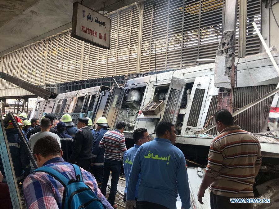 Rescuers work at a fire site at a train station in Cairo, Egypt, Feb. 27, 2019. At least 25 people were killed and more than 40 others wounded when a fire erupted inside the main train station in the city center of Egypt\'s capital Cairo on Wednesday, state-run Nile TV reported. (Xinhua/Ahmed Gomaa)