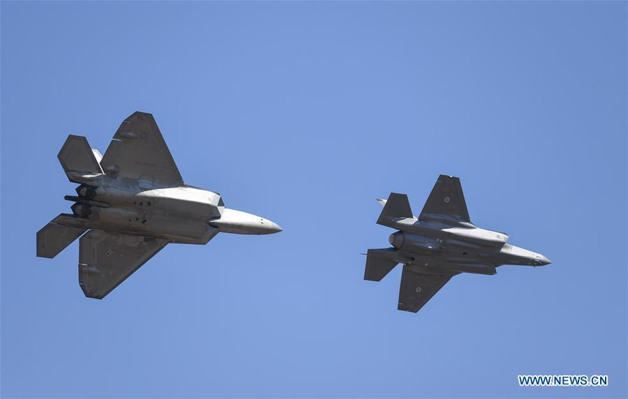 A U.S. Air Force F-22 and an Australian Defence Force F-35 perform during the Australian International Airshow and Aerospace & Defence Exposition at the Avalon Airport, Melbourne, on Feb. 28, 2019. (Xinhua/Bai Xuefei)
