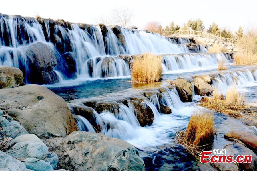 Melting snow in the Qilian Mountains caused water levels to rise in a river, forming a beautiful series of natural waterfalls in Zhangye City, Gansu Province as temperatures rose in late February. (Photo: China News Service/Chen Li)